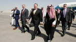 U.S. Secretary of State Mike Pompeo, second right in front, walks with Saudi Foreign Minister Adel al-Jubeir after arriving in Riyadh, Saudi Arabia, Tuesday, Oct. 16, 2018. (Leah Millis/Pool Photo via AP)