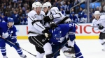 Los Angeles Kings defenceman Dion Phaneuf (3) and defenceman Drew Doughty (8) collide with Toronto Maple Leafs centre Zach Hyman (11) during second period NHL hockey action in Toronto on Monday, October 15, 2018. THE CANADIAN PRESS/Nathan Denette