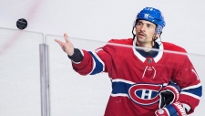 Montreal Canadiens' Tomas Plekanec throws a puck to fans following his 1000th NHL hockey game against the Detroit Red Wings in Montreal, Monday, October 15, 2018. THE CANADIAN PRESS/Graham Hughes