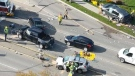 A crash near a busy intersection in Kitchener closed the road and hospitalized two people. (Source: Ron Wilcox)