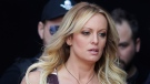 "In this Thursday, Oct. 11, 2018, file photo, adult film actress Stormy Daniels arrives for the opening of the adult entertainment fair ""Venus,"" in Berlin. (AP Photo/Markus Schreiber, File)"
