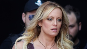 """In this Thursday, Oct. 11, 2018, file photo, adult film actress Stormy Daniels arrives for the opening of the adult entertainment fair """"Venus,"""" in Berlin. (AP Photo/Markus Schreiber, File)"""