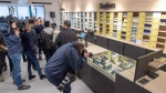 Photographers take pictures of the products during a media preview at Societe Quebecoise du Cannabis (SQDC) store Tuesday, October 16, 2018 in Montreal. The legal sale of cannabis begins in Canada on Wednesday, Oct. 17, 2018. THE CANADIAN PRESS/Ryan Remiorz
