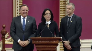 Premier-designate Francois Legault looks on as MNA Sonia Lebel is sworn in at the National Assembly.