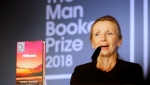 Writer Anna Burns delivers a speech after she was presented with the Man Booker Prize for Fiction 2018 by Britain's Camilla, the Duchess of Cornwall during the prize's 50th year at the Guildhall in London, Tuesday, Oct. 16, 2018.(AP Photo/Frank Augstein, Pool)