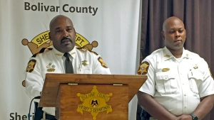 Bolivar County Sheriff Kelvin Williams, left, speaks to reporters at a news conference, Tuesday, Oct. 16, 2018, in Shaw, Miss., concerning a 20-month-old girl discovered dead in an oven. Accompanying the sheriff is Chief Deputy Gerald Wesley Jr. (Leah Allen /The Bolivar Commercial via AP)