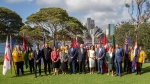 Britain's Prince Harry, center, and his wife Meghan, the Duchess of Sussex, center right, meet the Australian Governor-General Sir Peter Cosgrove and Lady Cosgrove, and representatives of Invictus Games participating countries in Sydney, Tuesday, Oct. 16, 2018. Prince Harry and his wife Meghan are on a 16-day tour of Australia and the South Pacific. (AP Photo/Steve Christo, Pool)