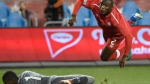 Canada's Zachary Brault-Guillard gets air as Dominica's Glenson Prince (1) makes a save during second half Concacaf Nations League qualifier soccer action in Toronto on Tuesday, October 16, 2018. THE CANADIAN PRESS/Nathan Denette