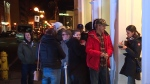 People wait for the first legal cannabis shop to open in St. John's, Nfld., late in the evening on Tuesday, Oct. 16, 2018.