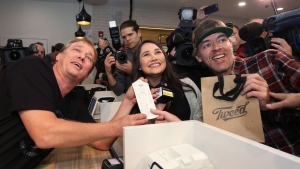 Canopy Growth CEO Bruce Linton, left to right, poses with the receipt for the first legal cannabis for recreation use sold in Canada to Nikki Rose and Ian Power at the Tweed shop on Water Street in St. John's N.L. at 12:01 am NDT on Wednesday October 17, 2018. THE CANADIAN PRESS/Paul Daly