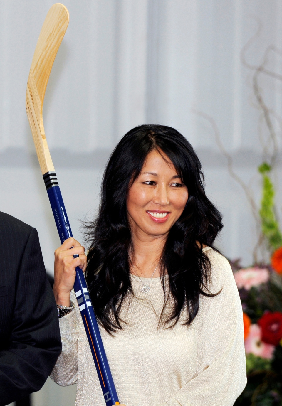 In this April 13, 2013, file photo, Kim Pegula poses during groundbreaking ceremonies at First Niagara Center in Buffalo, N.Y. The NHL is finally shrugging off its reputation as being a `men-only,' club with the Maple Leafs hiring Hayley Wickenheiser to a player development role, and Kim Pegula taking over as president of the Buffalo Sabres. (AP Photo/Gary Wiepert, File)