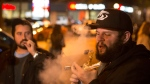 People smoke Cannabis on the street in Toronto on Wednesday October 17, 2018. Midnight signalled the legalization of Cannabis across Canada. THE CANADIAN PRESS/Chris Young