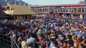 Hindu worshippers stand in long queues outside the Sabarimala temple in the southern Indian state of Kerala, on Dec. 1, 2015.  (Hareesh Kumar A S / AP)