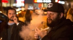 People smoke Cannabis on the street in Toronto on Wednesday, Oct.17, 2018. Midnight signaled the legalization of Cannabis across Canada. (Chris Young / THE CANADIAN PRESS)