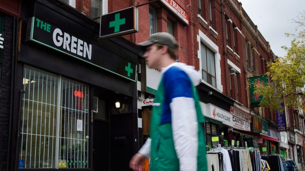 People walk past a cannabis dispensary in Toronto on Monday, October 15, 2018. THE CANADIAN PRESS/Christopher Katsarov