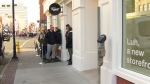 In this image taken from video, customers wait in line to purchase cannabis at a retail store on in, St. John's N.L., Wednesday, Oct.17, 2018.