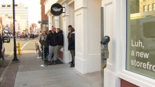 In this image taken from video, customers wait in line to purchase cannabis at a retail store in, St. John's N.L., Wednesday, Oct.17, 2018.