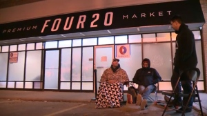 A few people lined up outside the Four20 Premium Market in Calgary on the first day of cannabis legalization.