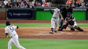 Boston Red Sox's Jackie Bradley Jr., right, watches his grand slam off Houston Astros relief pitcher Roberto Osuna during the eighth inning in Game 3 of the American League Championship Series on Tuesday, Oct. 16, 2018, in Houston.(AP Photo/Lynne Sladky)