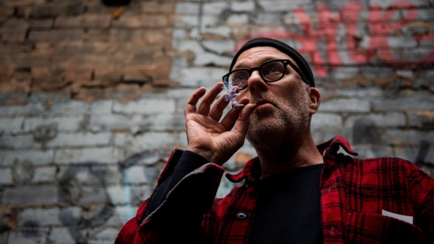 "Jimson Bienenstock smokes a joint during a ""Wake and Bake"" legalized marijuana event in Toronto on Wednesday, October 17, 2018. THE CANADIAN PRESS/Christopher Katsarov"