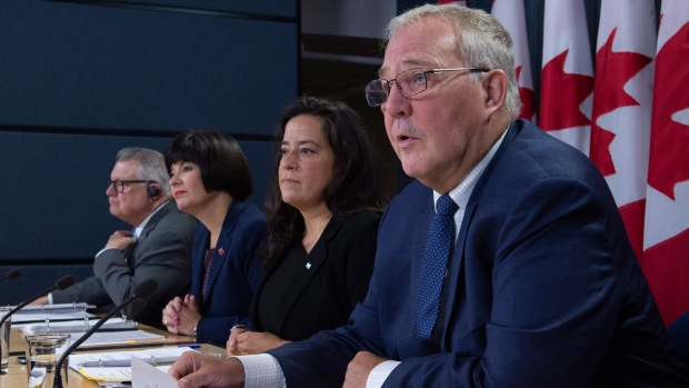 Public Safety and Emergency Preparedness Minister Ralph Goodale (left to right), Minister of Health Ginette Petitpas Taylor and Minister of Justice and Attorney General of Canada Jody Wilson-Raybould listen as Minister of Border Security and Organized Crime Reduction Bill Blair speaks during a news conference on legalized cannabis in Ottawa, Wednesday, October 17, 2018. THE CANADIAN PRESS/Adrian Wyld