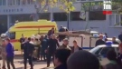 This image made from video, shows the scene as emergency services load an injured person onto a truck, in Kerch, Crimea, Wednesday Oct. 17, 2018. (Kerch FM News / AP Photo)