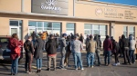 Customers line up at the retail cannabis store in Charlottetown, P.E.I., Wednesday October 17, 2018. (THE CANADIAN PRESS/Brian McInnis)