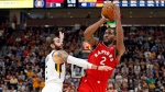 Toronto Raptors forward Kawhi Leonard (2) shoots as Utah Jazz's Joe Ingles, bottom, falls and Ricky Rubio (3) defends in the first half of an NBA preseason basketball game in Salt Lake City on October 2, 2018. THE CANADIAN PRESS/AP, Rick Bowmer