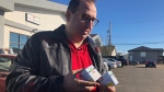 Allan Kennedy is trying out two new products bought from Jimmy's Cannabis Shop in Martensville, spending $90 on seven grams. (Angelina Irinici/CTV Saskatoon)