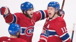 Montreal Canadiens' Brendan Gallagher (11) celebrates with teammates Phillip Danault (24) and Tomas Tatar after scoring against the St. Louis Blues during third period NHl hockey action in Montreal, Wednesday, October 17, 2018. THE CANADIAN PRESS/Graham Hughes