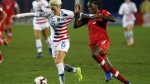 USA forward Megan Rapinoe (15) and Canada Kadeisha Buchanan battle for the ball in the first half of the finals of the CONCACAF Women's soccer Championship on Wednesday, Oct. 17, 2018, in Frisco, Texas. (AP Photo/Richard W. Rodriguez)