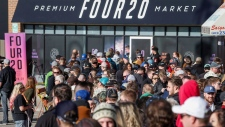 People line-up to purchase legal cannabis in Calgary, Alta., Wednesday, Oct. 17, 2018. THE CANADIAN PRESS/Jeff McIntosh