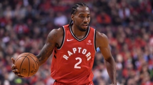 Toronto Raptors forward Kawhi Leonard (2) takes the ball up court against the Cleveland Cavaliers during first half NBA basketball action in Toronto on Wednesday, October 17, 2018. THE CANADIAN PRESS/Nathan Denette