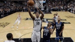 San Antonio Spurs guard DeMar DeRozan (10) scores past Minnesota Timberwolves guard Andrew Wiggins (22) during the second half of an NBA basketball game, Wednesday, Oct. 17, 2018, in San Antonio. San Antonio won 112-108. (AP Photo/Eric Gay)