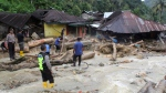 Rescuers search for victims following a flash flood in Mandailing Natal district, North Sumatra, Indonesia, Saturday, Oct. 13, 2018. Torrential rains triggered flash floods and landslides on the Indonesian island of Sumatra, killing a number of children at a devastated school. (AP Photo/Khairul Bazar)