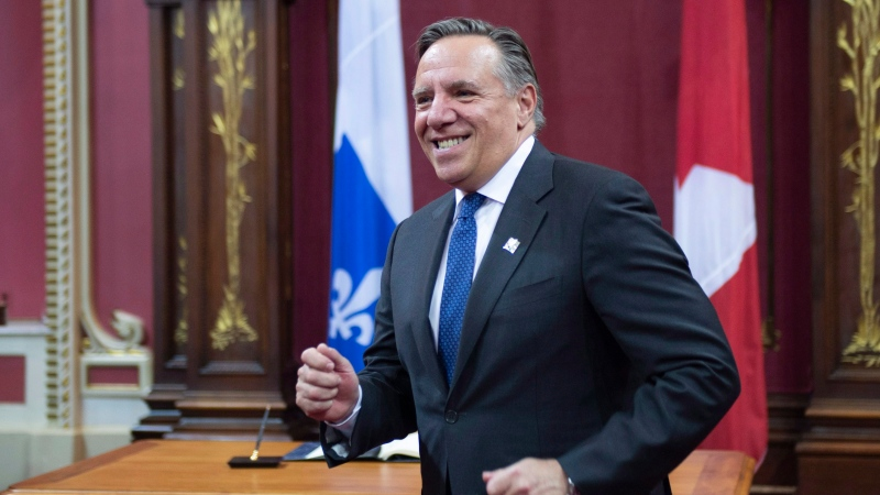Quebec Premier designate Francois Legault walks to his wife after he was sworn in as member of the National Assembly Tuesday, October 16, 2018 at the legislature in Quebec City. THE CANADIAN PRESS/Jacques Boissinot