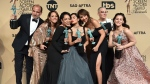 "Cast members pose with the award for outstanding performance by an ensemble in a comedy series for ""Orange Is The New Black"" at the 23rd annual Screen Actors Guild Awards in Los Angeles on Jan. 29, 2017. (Photo by Jordan Strauss/Invision/AP)"