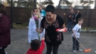 Katrina Anderson receives flowers from a child at an impromptu community gathering in St. Albert Wednesday, Oct. 17, 2018. (Facebook/Kristin Kat)
