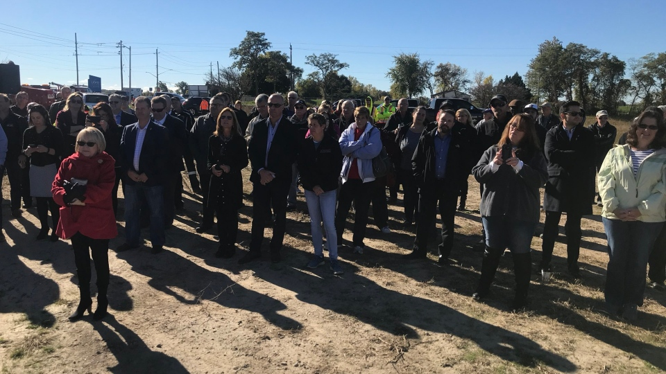 A crowd gathers at the site of a new hotel in Amherstburg, Ont., on Thursday, Oct. 18, 2018. (Rich Garton / CTV Windsor)