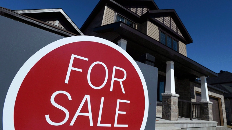 A sign advertises a new home for sale in Carleton Place, Ont., on March 17, 2015. THE CANADIAN PRESS/Sean Kilpatrick