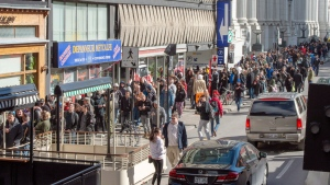 Hundreds of people lineup at a government cannabis store Wednesday, Oct. 17, 2018 in Montreal as the legal sale of cannabis begins in Canada. THE CANADIAN PRESS/Ryan Remiorz