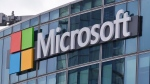 FILE - This April 12, 2016 file photo shows the Microsoft logo in Issy-les-Moulineaux, outside Paris, France. (AP Photo/Michel Euler, File)