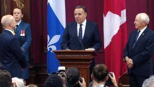Francois Legault is sworn in as premier of Quebec, at the legislature in Quebec City, Thursday, Oct. 18, 2018.