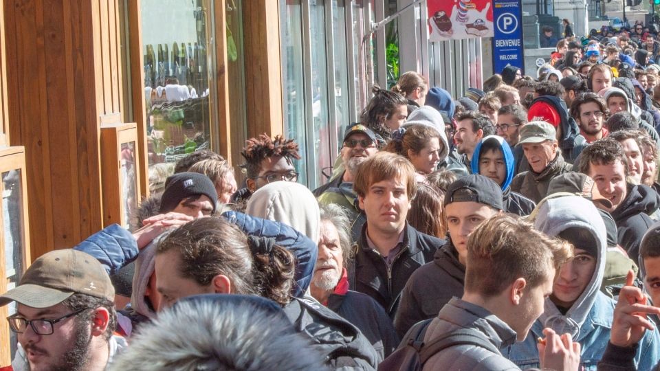 Hundreds of people lineup at a government cannabis store Wednesday, October 17, 2018 in Montreal as the legal sale of cannabis begins in Canada. (THE CANADIAN PRESS/Ryan Remiorz)