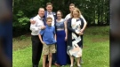 Const. Sara Burns, her husband Steven, and their four children.