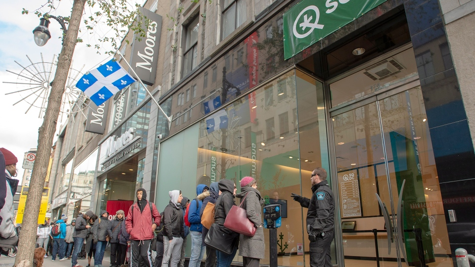 Customers lineup at a government cannabis store Thursday, Oct. 18, 2018 in Montreal on the second day of the legal cannabis sales in Canada. THE CANADIAN PRESS/Ryan Remiorz