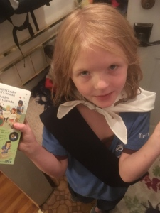 Elina Childs holds a box of Girl Guide cookies.