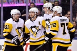 Pittsburgh Penguins centre Evgeni Malkin, second from right, celebrates his goal against the Toronto Maple Leafs with teammates Phil Kessel, left to right, Kris Letang and Patric Hornqvist during first period NHL hockey action in Toronto on Thursday, October 18, 2018. (THE CANADIAN PRESS/Frank Gunn)