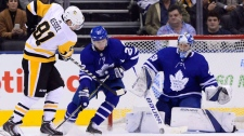 Pittsburgh Penguins right wing Phil Kessel (81) is topped by Toronto Maple Leafs goaltender Frederik Andersen (31) as Toronto Maple Leafs defenceman Nikita Zaitsev (22) defends during second period NHL hockey action in Toronto on Thursday, October 18, 2018. THE CANADIAN PRESS/Frank Gunn