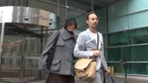 Jennifer and Jeromie Clark exit the Calgary Courts Centre on October 1, 2018